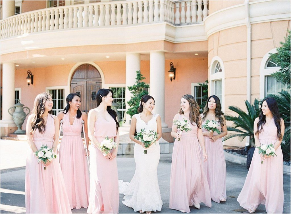 bride walking with bridesmaids at Chateau Polonez wedding