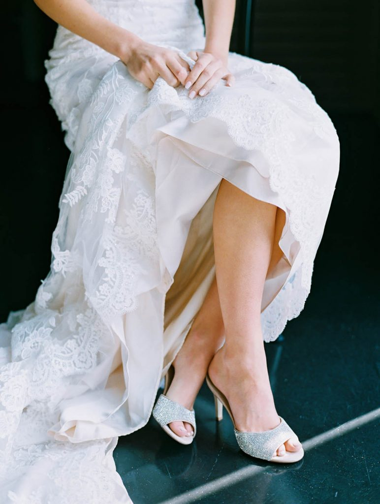 a portrait of the bride's shoes and her train