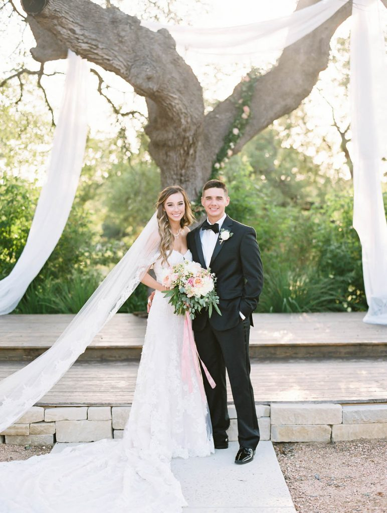 a classic bride and groom portrait at the altar