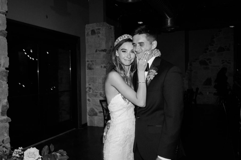 the bride pinching the groom's cheeks