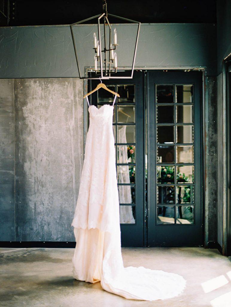 the bride's justin alexander dress hangs at park 31