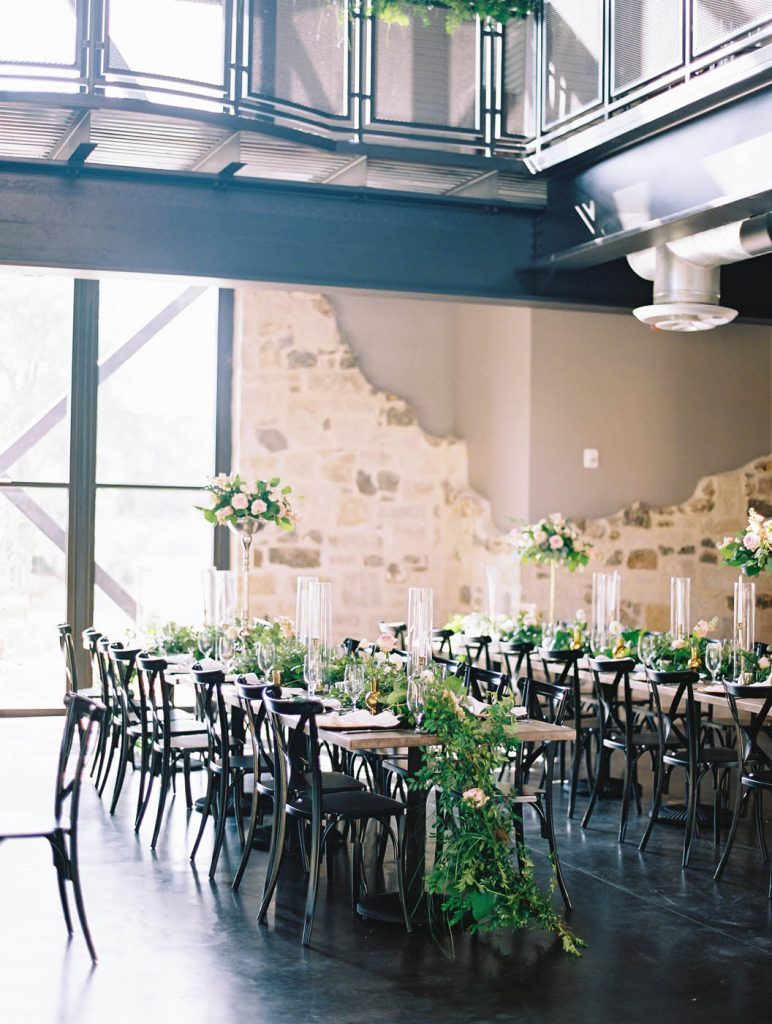 dinner tables at Park 31 with greenery garlands