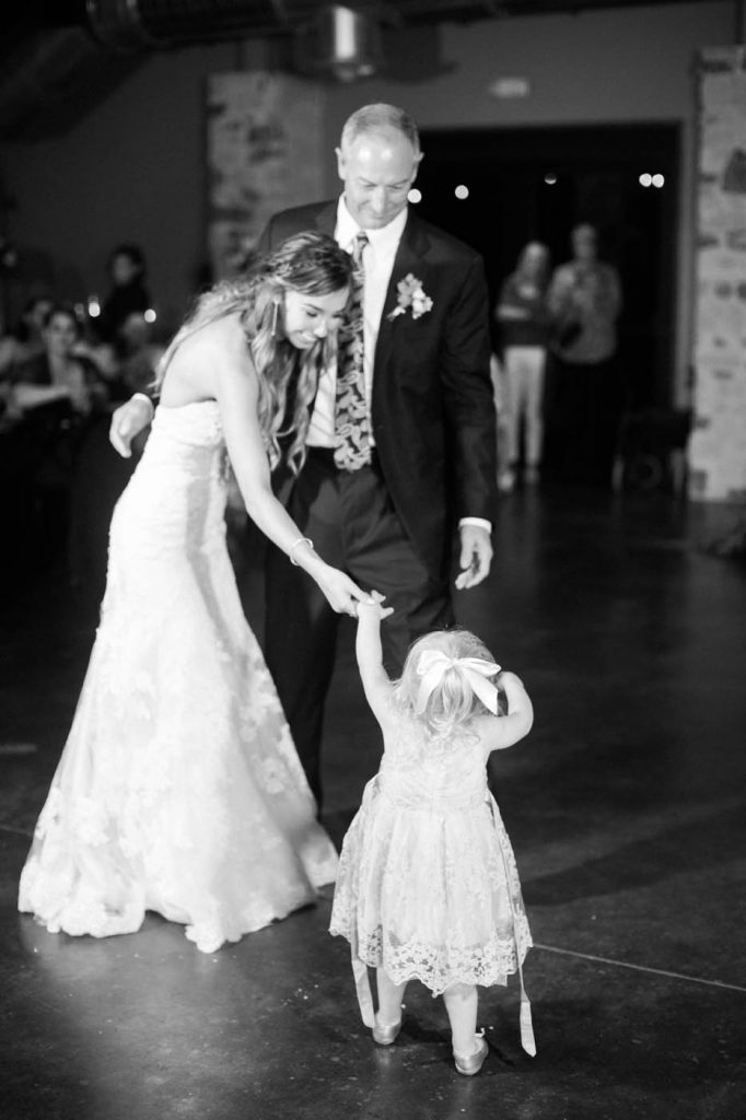a little girl joins the father daughter dance