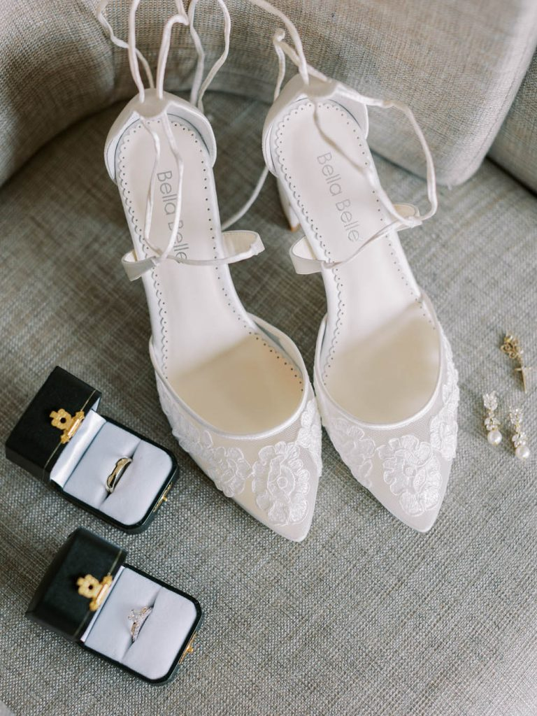 flatlay with bella belle shoes and wedding rings