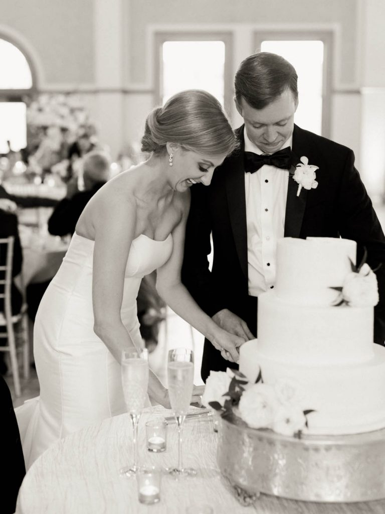 The bride and groom cut their cake together