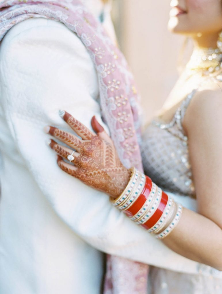 The bride's henna with her engagement ring
