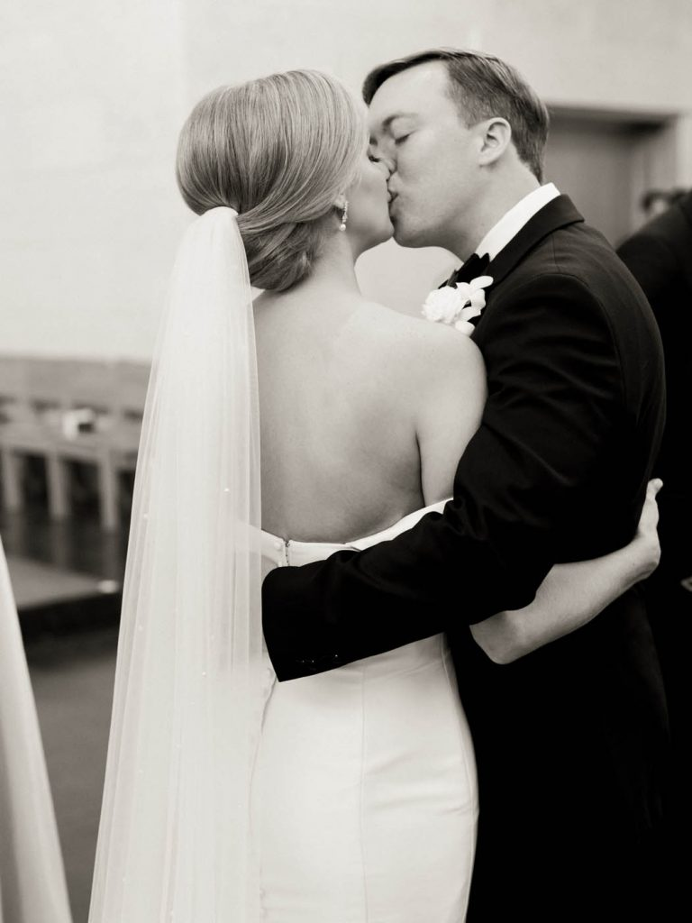the bride and groom kiss after the ceremony