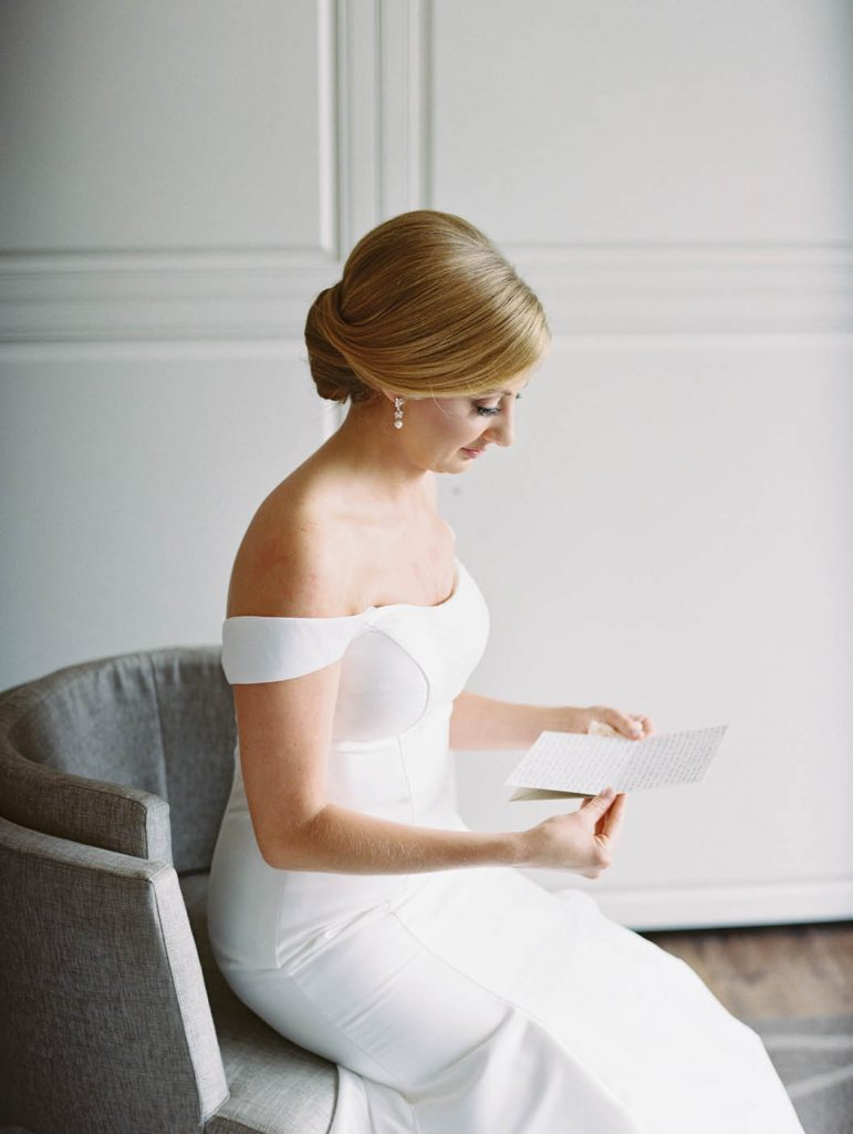 the bride reads a letter from the groom at the Worthington Renaissance in Fort Worth