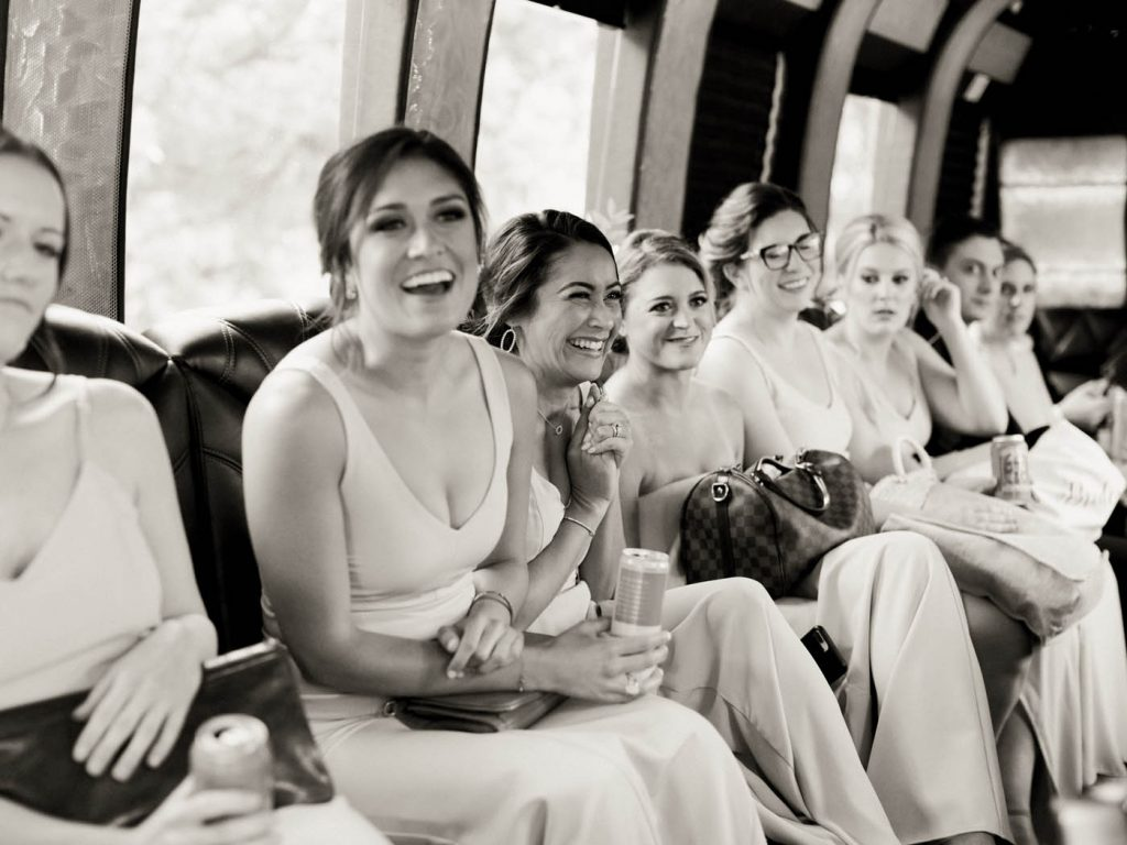 a bridesmaid laughs on the way to the reception
