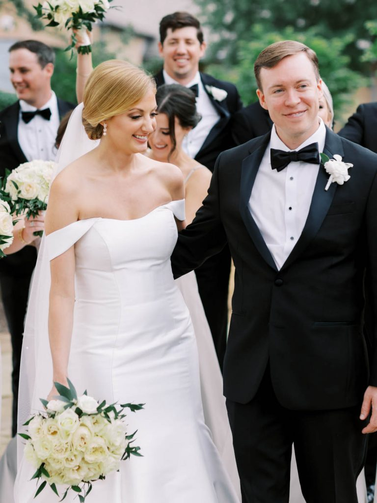 the bride and groom smile together