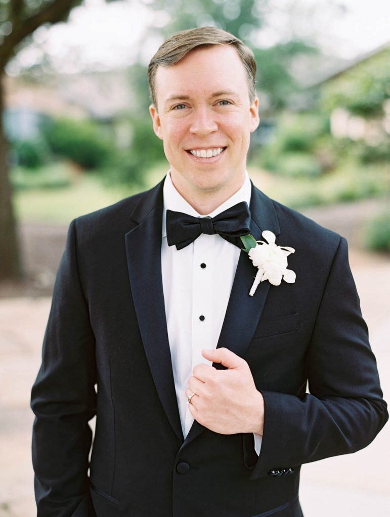 classic groom portrait in black tuxedo
