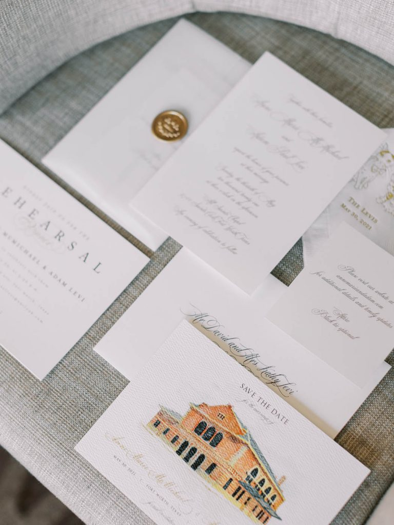 wedding invitation flatlay with custom venue illustration
