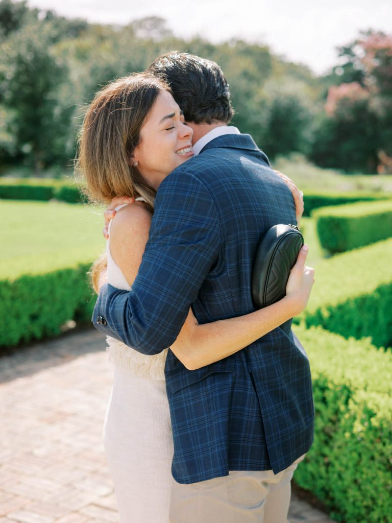 The couple hugs after becoming engaged