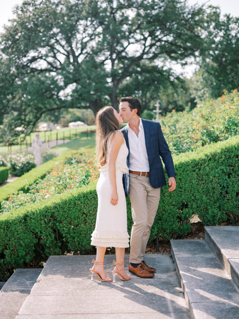 The couple kisses on the stairs of the Commodore Perry