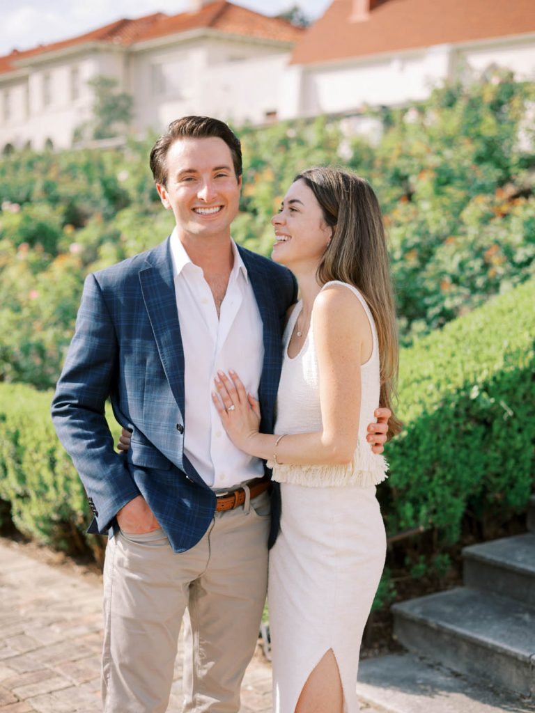 The couple laughs together in the garden of the Commodore Perry