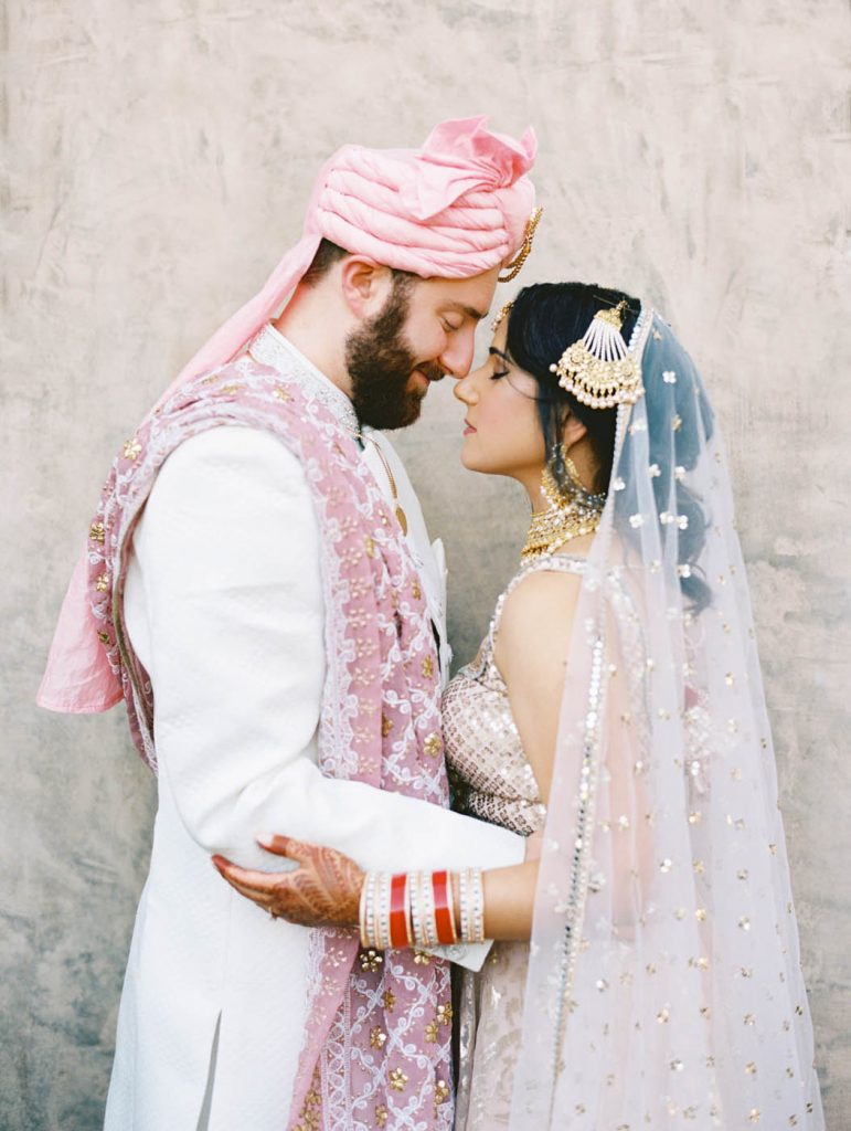 The indian bride and groom pose together