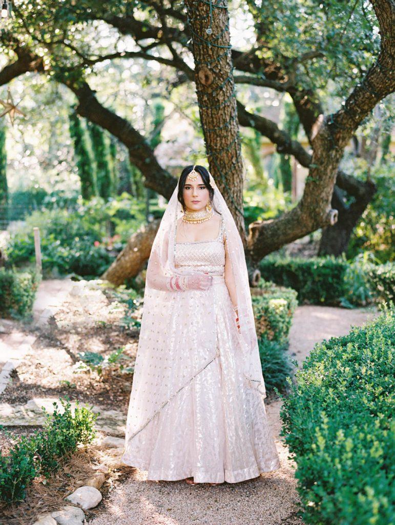 an indian bride in her lehenga