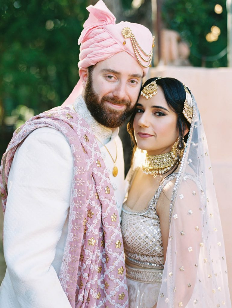 portrait of the bride in her lehenga and the groom in his sherwani